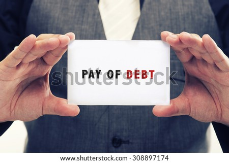 Executive Holding card with Message Saying-Pay of debt - stock photo