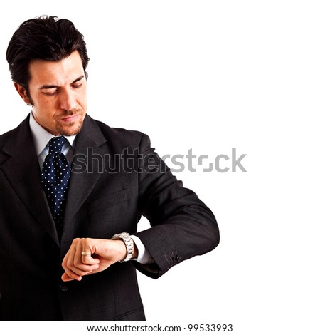 Executive looking at the watch. Focus on the hand