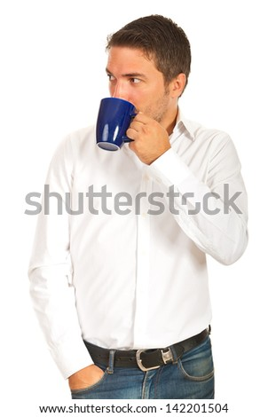 Executive man drinking coffee and looking away to copy space isolated on white background - stock photo