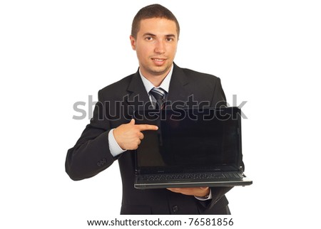 Executive man pointing to laptop screen and smiling isolated on white background