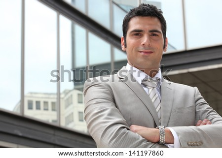 Executive outside an office building - stock photo