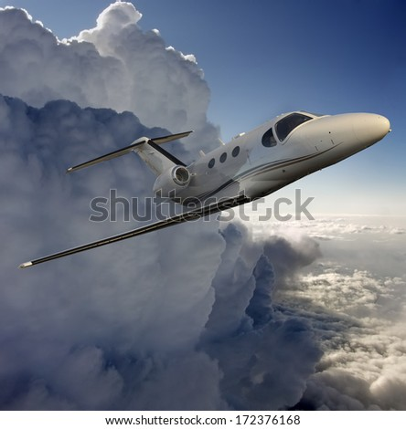 Executive plane flying away from a storm - stock photo