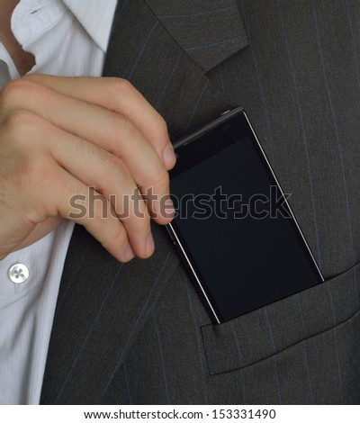 Executive saving or taking your phone in the jacket - stock photo
