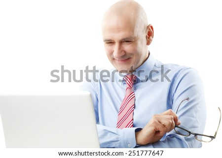 Executive senior financier officer sitting in front of computer and analyzing financial situation.