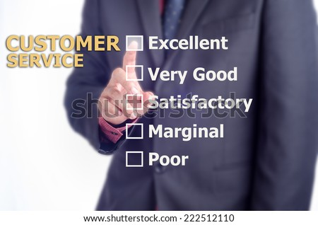 Executive touch the CUSTOMER SERVICE evaluation form on the virtual screen - stock photo