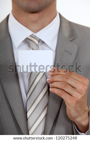 Executive with a blank business card - stock photo