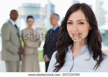 Executive woman showing a beaming smile in front of the camera - stock photo