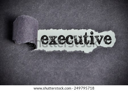 executive word under torn black sugar paper  - stock photo