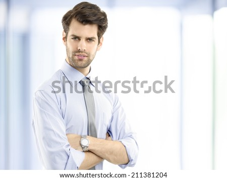 Executive young businessman standing at office. Business people.