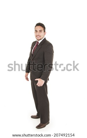 executive young good looking man wearing a dark standing suit isolated on white