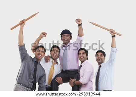Executives cheering during cricket match - stock photo