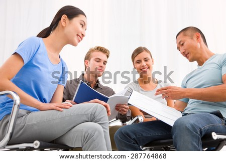 Executives discussing papers meeting - stock photo