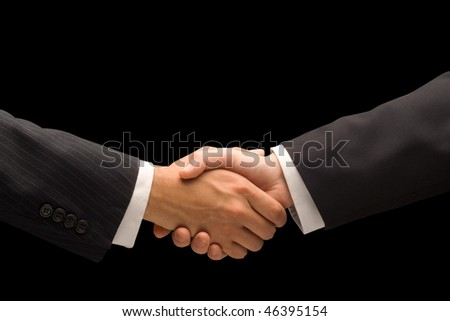 Executives handshake against a black background