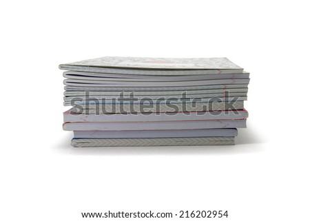 exercise books on a white background - stock photo