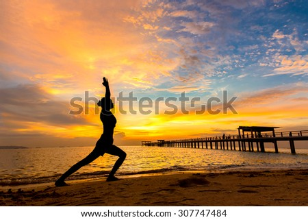Exercise by doing Yoga by the Sea. - stock photo