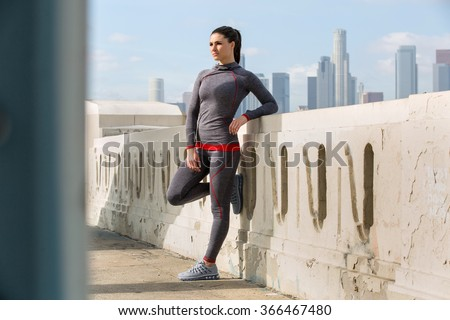 Exercise fitness women's sportswear fit thin physique athletic build outdoor city skyline confident