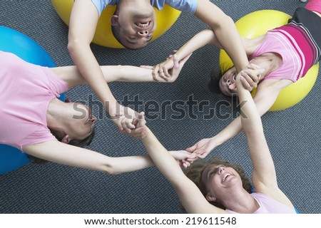 Exercise group grabbing hands - stock photo