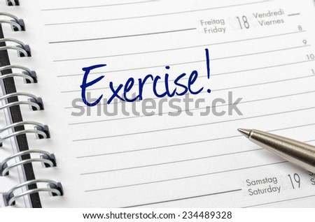 Exercise written on a calendar page - stock photo