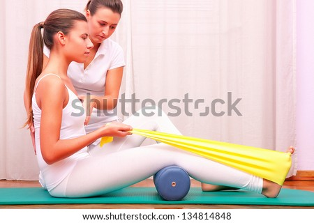 exercises with elastic strengthening tibial tarsal - stock photo