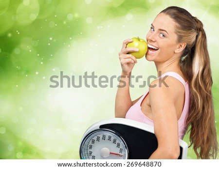 Exercising, Dieting, Weight Scale. - stock photo