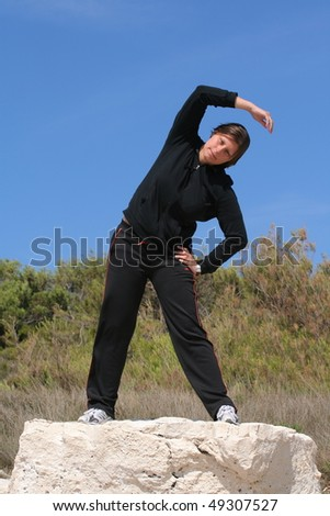 Exercising woman - stock photo