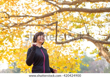 Exercising young Asian woman. - stock photo