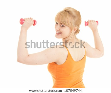 exercising young woman working out in the gym and curling with small dumbbells