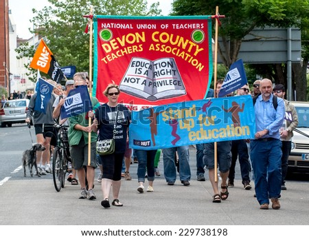 EXETER - JULY 10: The J10 march walks along Sidwell Street during the public sector workers national day of action in  Exeter City Centre on July 10,  2014 in Exeter, Devon, UK - stock photo