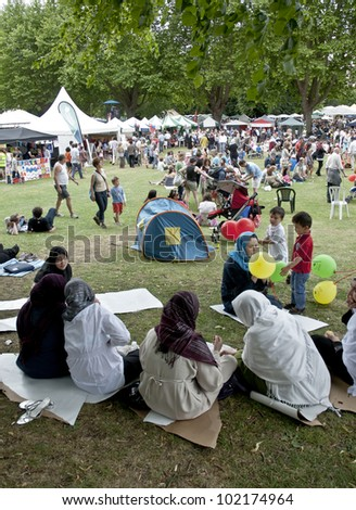 EXETER - JUNE 4: Festival goers at the Exeter Respect Festival sit in the park and enjoy the day  on June 4, 2011 in Exeter, UK.