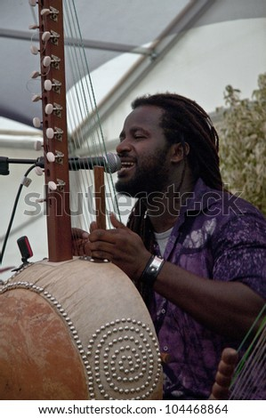 EXETER -  JUNE 2: Modou N'Diaye performing live in the Acoustic Cafe at the Exeter Respect Festival 2012 on June 2, 2012 in Exeter, UK