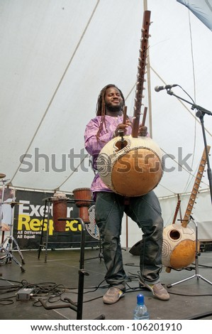 EXETER - JUNE 3: Modou N'Diaye plays the Kora live on the Global Community Stage at the Exeter Respect Festival 2012 on June 3, 2012 in Exeter, UK
