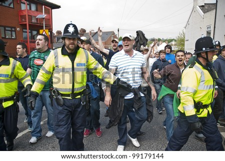 EXETER - MARCH 31: Devon and Cornwall Police escort football fans to prevent football violence at the League 1 match between Exeter City FC and Plymouth Argyle FC