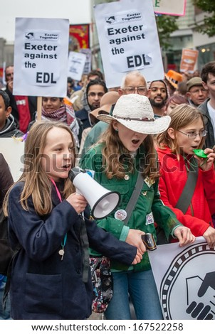 EXETER - NOVEMBER 16: Children take to the megaphone to denounce the EDL during the Exeter Together march and diversity festival on November 16, 2013 in Exeter, Devon, UK - stock photo