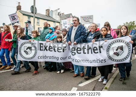 EXETER - NOVEMBER 16: Exeter Together march through the streets during the Exeter Together march and diversity festival on November 16, 2013 in Exeter, Devon, UK - stock photo