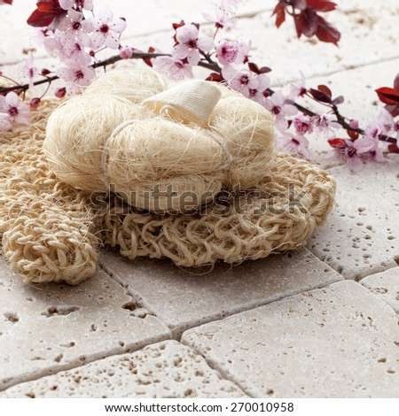 exfoliate for beauty and purity at the spa with Spring flowers - stock photo