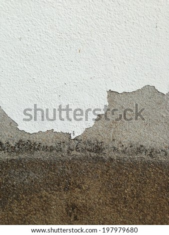 exfoliated cement wall background - stock photo