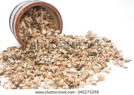 Exfoliated perlite and vermiculite for gardening on white background - stock photo