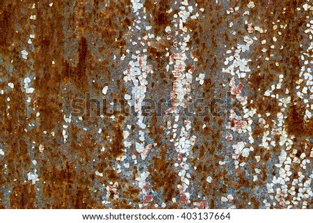 exfoliating paint on an old rusty metal surface - stock photo