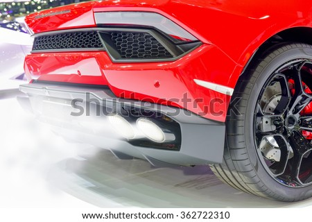 Exhaust fumes pipe during starting engine of a red car - stock photo