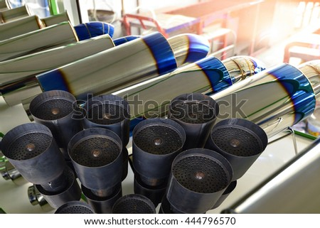exhaust pipe for motor sports and car muffler  - stock photo