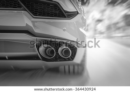 Exhaust pipe of a car , black and white - stock photo