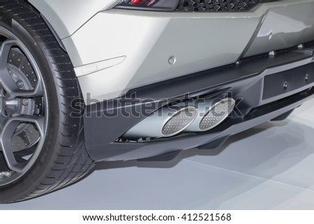 Exhaust pipe of a gray car - stock photo