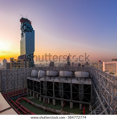 Exhaust vents of industrial air conditioning and ventilation units. Skyscraper roof top from high building. - stock photo