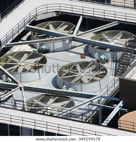 Exhaust vents of industrial air conditioning and ventilation units. Skyscraper roof top in New York, USA. - stock photo