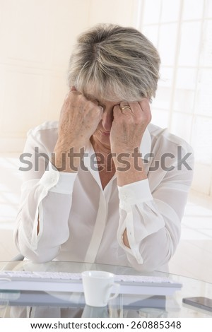 Exhausted and tired eyes business executive woman. - stock photo