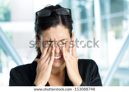 Exhausted and tired eyes business executive woman. Businesswoman stress and problems in job. - stock photo