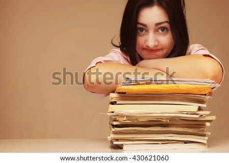 exhausted beautiful business woman holding document folder - stock photo