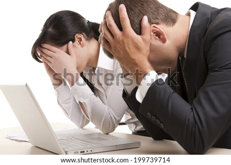 Exhausted busienss poeple, maybe after having received bad news - stock photo