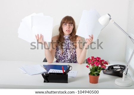 Exhausted business woman with annoying documentation - stock photo