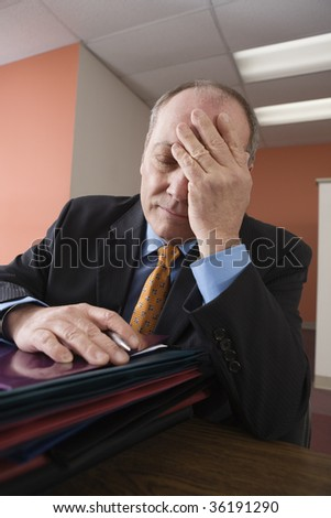 Exhausted businessman - stock photo